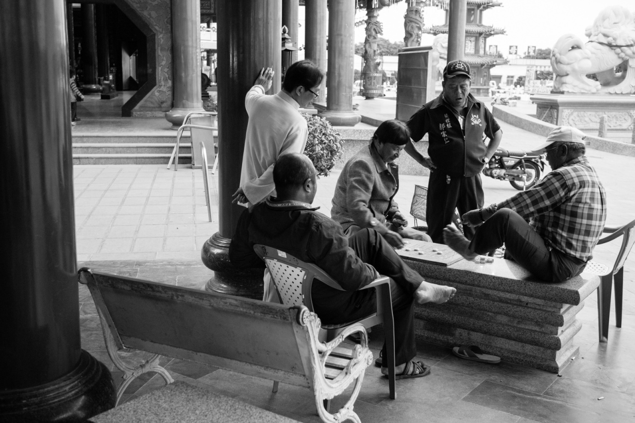 Locals playing chinese chess at one of side buildings of the matsu temple